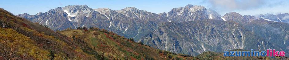 2015/9/28【種池山荘周辺の紅葉】山荘周りの紅葉とその先には左に立山連峰、右に剣岳が眼前に迫り圧倒的な迫力です。